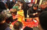 Customers purchase gold products at a gold shop in Nantong, China.
